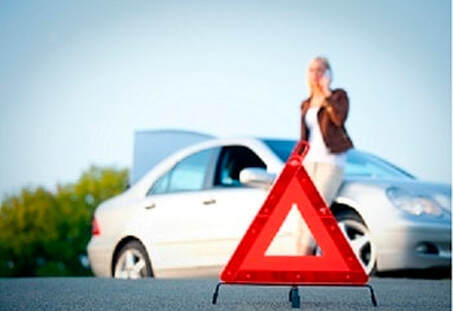 triangle roadsign with a girl on the back with her phone