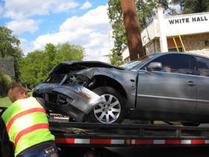 damaged car on a tow truck
